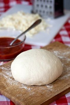 Perfect Pizza Dough    1/2 cup warm water  2 1/4 tsp. instant yeast  4 cups (22 oz.) bread flour, plus more for dusting  1 1/2 tsp. salt  1 1/4 cup water, at room temperature  2 tbsp. extra-virgin olive oil