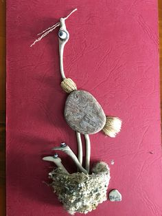 Pebble art and driftwood Mother and chicks in original birds nest by gülen