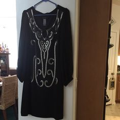 Black dress Black dress with sleeves that are split. Silver beading on front. Size 16. Most of my items are on sale due to weight loss and items are to big. Dresses Long Sleeve