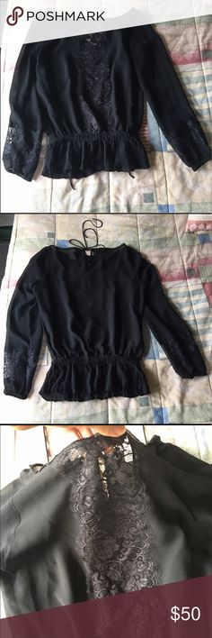 Black Lace Cache Blouse. XS Sheer black lace Cache Blouse, size XS. String to tie up the back. Peplum fit. Cache Tops Blouses