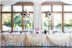 Centerpieces add a beautiful touch to the head table elements.