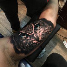 bicep owl tattoo
