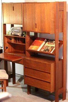 Imagine this as a built in, fold out wall office and desk doubles as a bookshelf/entertainment center.  A larger fold out could serve the purpose of dining/drafting table as well.