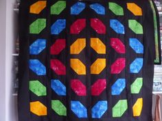 The church windows quilt block is an incredibly simple 4 patch block which makes a striking quilt using bright colours with a black background.