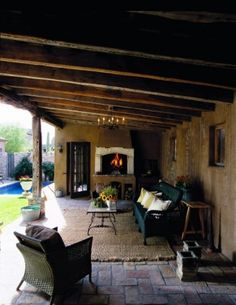 Oooh!  Love the beams and the adobe fireplace.  Probably would keep the walls a more modern siding