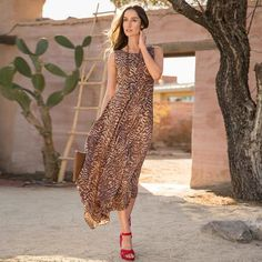 SALMA DRESS - This patterned rayon maxi dress is a natural choice for any occasion.