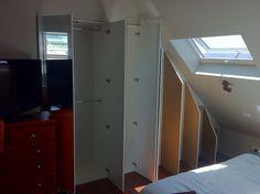 Loft conversion wardrobe and storage.