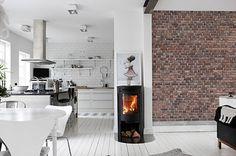 Wil je ook een mooie bakstenen muur binnen huis? Klik hier hoe je deze kan creëren en bekijk mooie inspiratiefoto's en leuke ideeën!