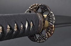 Fully Handmade Damascus Japanese Samurai Fan Katana sword #270 by Handmade Sword. $209.99. Blade:Damascus blade,heat tempered;Edge: sharp;Hamon: Obvious hamon,hand polished on;Hi(blood groove): Hi on each side;Tsuka(handle): Genuine Rayskin & black Japanese cotton Ito with Menuki (Ornament);Saya: Black piano lacquered wood with black cotton Sageo;Tang: Signed full tang;Tsuba: Real gold & silver plated Fan Tsuba;Condition: Brand new & can be fully disassembled a...