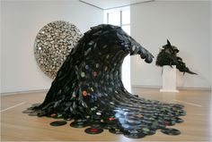 """On Korean artist Jean Shin created """"Sound Wave"""" out of melted vinyl records. The artist explained the sculpture shows """"the inevitable waves of technology that render each successive generation of recordable media obsolete. Vinyl Record Art, Old Vinyl Records, Vinyl Art, Vinyl Music, Vintage Records, Crafts From Recycled Materials, Recycled Art, Art Sculpture, Sculptures"""