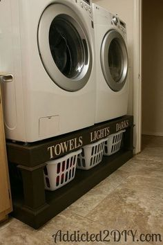 Laundry baskets under washer and dryer.