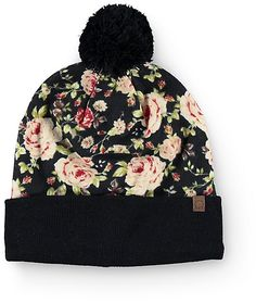 Update any look with some lush style in this beanie that features a ultra soft floral print body accented with a solid black pom at the top and knit cuff.