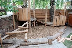 In the small garden areas of this Paignton early years centre we made spaces for children to climb, play with sand and water and engage in imaginative role play.