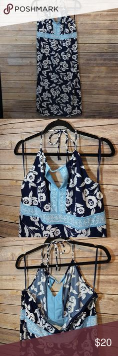Ann Taylor Loft Blue Flower Halter Dress Gorgeous navy blue dress with baby blue accents. The dress has a string halter that Tues behind the neck. Lined with an ant-slip grip in the back. Barely worn in great condition! Ann Taylor Dresses Midi