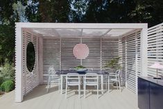 """2LG Studio founders create garden pavilion with a """"touch of Beetlejuice"""" Outdoor Seating Areas, Outdoor Dining, Outdoor Spaces, Outdoor Decor, Commercial Interior Design, Interior Design Studio, Interior Design Services, Green Kitchen Interior, Table Verte"""