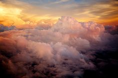 Rising from the darkness.  from an airplane window.  by Sean Frego.