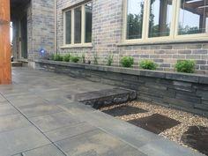 Rinox Solino Wall, Hampton Limestone Step and Flagstone installed by Platinum Stone Design