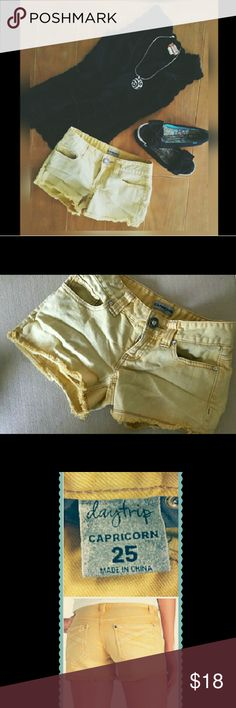"""Capricorn Daytrip Cutoff Shorts Super cute never worn Daytrip cutoffs from Buckle. Capricorn style. Size 25 Gorgeous washed out burnt yellow color with rhinestones/crystal details. Contrast stitching and fringed hem. 99.4% Cotton 0.6% Spandex for that perfect bit of stretch. Approx Measurements laying flat W 14"""" L 11.5"""" Inseam 3"""" Daytrip Shorts"""