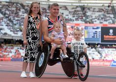 David Weir celebrates with his children Ronie, Tillia Grace and Mason after winning the men's one mile during the Sainsburys International Para Challenge at the Olympic Stadium, London. Photo: Adam Davy/PA Wire