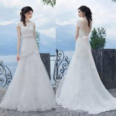 2016 Lace Sheer Wedding Dresses Beads Sash Applique Sleeveless Lace Up A-Line Bridal Ball Gowns Sweep Train Vestido De Novia Tulle Online with $104.78/Piece on Hjklp88's Store