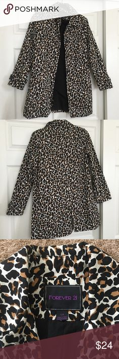 FINAL PRICE Forever 21 Leopard Print Cotton Coat SIZE SMALL. This Forever 21 Leopard Print Coat is a head turner! It is made of cotton and fully lined, it also has buttons that close on the front. This coat was worn less than a handful of times and is in great condition. The only flaw is that there is a hole in the pocket of the coat (image 4), otherwise there is no other visible wear. Forever 21 Jackets & Coats