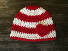 Adorable boy or girls Valentines Day beanie. The festive colors and heart applique make this hat perfect for your little sweetheart this