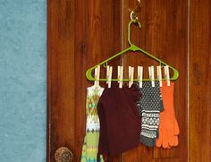 Clamp accessories to hangers with clothespins.