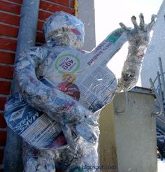 Sculpture made of newspaper and tape on 12 ours public street art event with artist Line Frøslev
