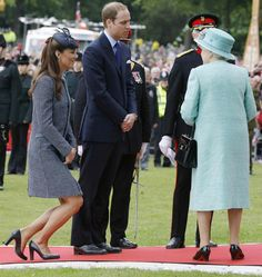 Catherine, Duchess of Cambridge curtsies to Queen Elizabeth as she and her husband Prince William bid farewell to the monarch after visiting Nottingham on June 13. - GETTY IMAGES