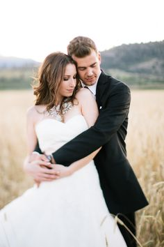 Wedding portrait in a field at sunset