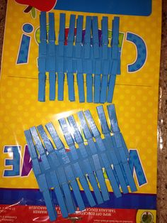Spray painted clothes pins and used a hot glue gun to stick the tacks to them. I plan on using them for my bulletin board in my classroom.