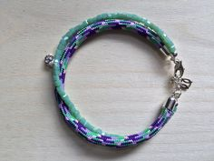 Mint glass beads, sterling silver and paracord bracelet by MastoriJewelry on Etsy