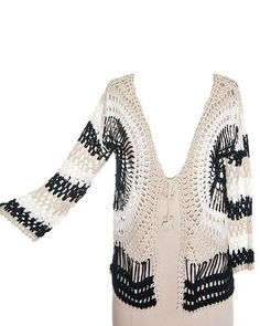 Super chic, holey knit cardigan featuring a white, beige and black striped/circular pattern, crocheted string closure with slightly flared sleeves. Available in Small, Medium and Large. 65% Polyester/35%Cotton $27.99