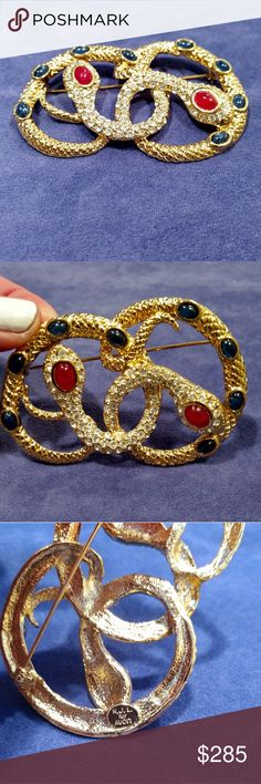 Stunning Kenneth Jay Lane Rhinestone Medusa Brooch Stunning Kenneth Jay Lane Cobochon Rhinestone  Medusa Snake Brooch. Blue and red cabochon stones and shiny bright rhinestones on gold tone metal pin. Perfect condition. Sells for $350 on eBay. Kenneth Jay Lane Jewelry Brooches