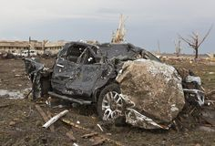 A heavily-battered truck, in a field near the Moore Medical Center, background, after a tornado moves through Moore, Oklahoma, on May 20, 2013. (AP Photo/Alonzo Adams)