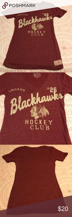 Retro Chicago Blackhawks T-shirt Chicago Blackhawks retro v neck style t-shirt. Color is a heather red. Print is khaki color. Size small. Worn one. Looks brand new! GUC  Make me an offer or add to a bundle for a private discount! Newbury Tops Tees - Short Sleeve