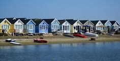 Mudeford Quay is situated at the entrance to Christchurch Harbour and provides spectacular views out to sea and back to Christchurch town. Mudeford Beach Huts, Places In England, Summer Design, Bournemouth, My Land, Little Houses, Surrey, Hampshire, Places To Visit