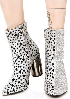 Party Planet Boots are dancin' thru the astral plane, bb! These amazing boots feature an iridescent silver glitter outer, black 'N silver star printed inner, tapered toe, block heel with golden hardware trim, and inner ankle zip closures.