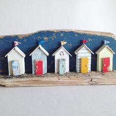 Lovely miniature beach hut scene all handmade from driftwood and reclaimed materials. Huts come complete with their own flags and distressed driftwood doors. Wood Block Crafts, Wooden Crafts, Wood Blocks, Driftwood Projects, Driftwood Art, Deco Marine, Beach Cottage Style, Beach Crafts, Kids Crafts