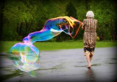 old woman, bare feet, soap bubbles