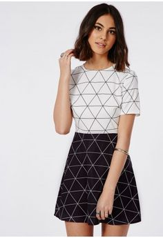 Channel major style edit vibes this season in this chic skater dress. With contrasting white to the top and black to skirt this short sleeve skater dress with monochrome diamond grid print is lust-worthy. Style up with over the knee boots f...