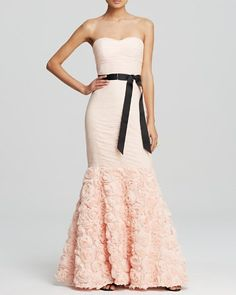 cute dress for prom. love the pink ruffles with black sash!