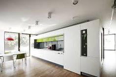 Black on White / Parasite Studio Black on White / Parasite Studio - The living room, kitchen and dining area are open functional areas contained by a large space, partially delimited by the white walls, similar to the courtyards. Beautiful Kitchen Designs, Beautiful Kitchens, Modern Interior, Interior And Exterior, Interior Design, Kitchen Colors, Kitchen Decor, Room Kitchen, Ideas Hogar
