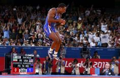 Jordan Ernest Burroughs of U.S. reacts after defeating Iran's Sadegh Saeed Goudarzi on the final of the Men's 74Kg Freestyle wrestling at the ExCel venue during the London 2012 Olympic Games August 10, 2012.