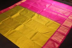 Olive green kanchipuram silk saree with pink tissue korvai border and pallu with simple temple border design  only available at parijatstore.com