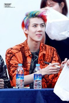 cute magnae sehun with his rainbow hair- I bet every hair style would look good on him!