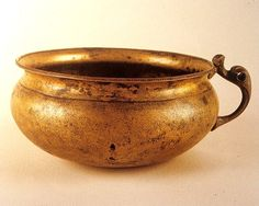 This beautiful bronze bowl was discovered in 1854 in a river flowing into Lough Scur, which lies just north of Keshcarrigan in Co. Letrim. Iron Age in date and measuring approximately 14 cm in diameter, it may have been a ceremonial drinking cup.