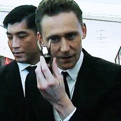 Sharpie marks on Tom's hand from furiously signing tiny Loki hats.