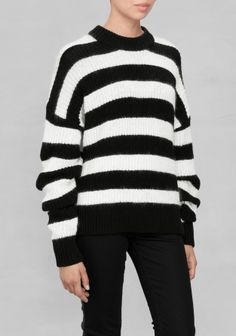 This chunky sweater made from soft mohair blend with fuzzy feel features oversized sleeves and wide black and white stripes.