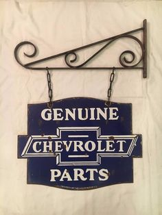 A reproduction porcelain enamel chevrolet parts sign being passed chevrolet genuine parts 1940s vintage porcelain 2 sided with angle enamel sign chevroletgenuineparts sciox Choice Image